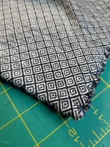 Close up on the edge blanket stitching on the diamond twill shawl