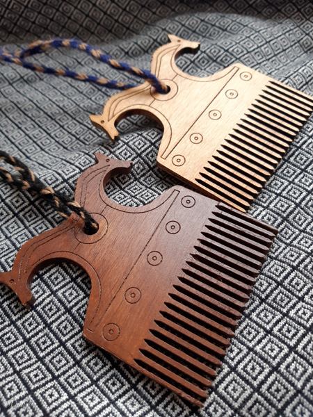 Finished laser cut Viking-inspired wooden combs in two different stain colours