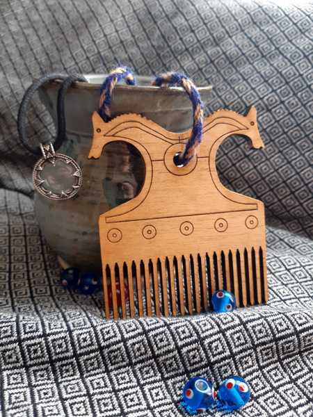 Finished laser cut horse head Viking-inspired wooden comb stained with Royal Walnut