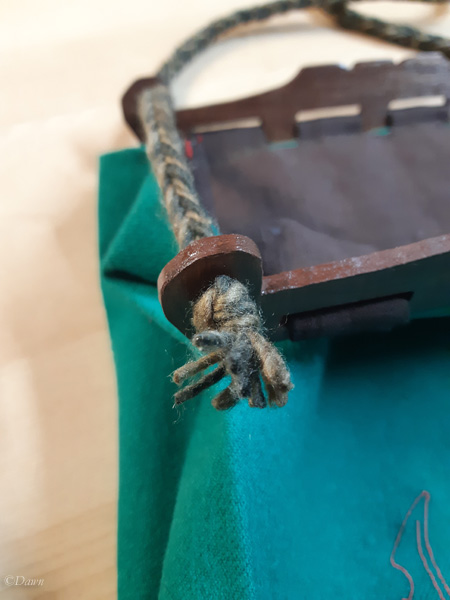 Close up on the Hedeby style bag strap through the wooden handles