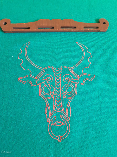 Selecting this handle to go with this embroidered fabric.