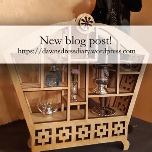 Wood Asian-inspired miniature doll shelf.