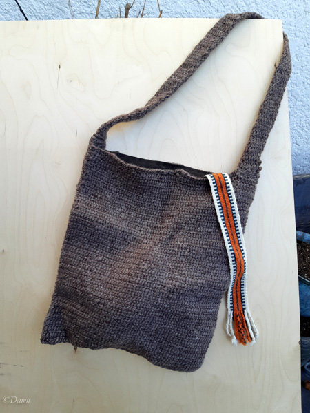 Finished naalbound tote bag with some tablet weaving inside