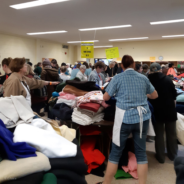 The somewhat organized chaos inside the 2019 Grandmother's Fabric Sale