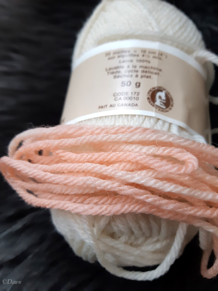 Pink wool yarn from my first woad experiment, along with the original ball it came from to compare the original colour.