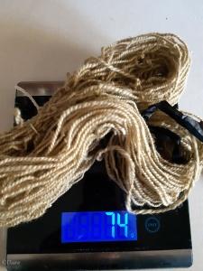 74 grams of handspun 2-ply Romney wool yarn after being treated in the rhubarb bath.