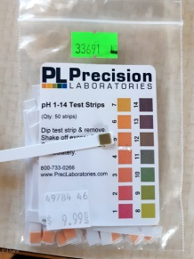 testing the pH of my wood ash lye - about a 12