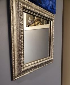 upcycled mirror frame in my bathroom