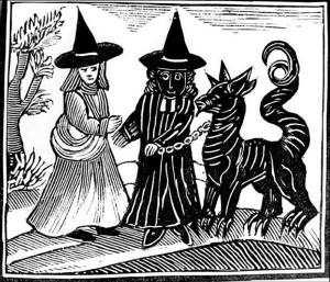 Two witches with a Satanic beast. Public Domain