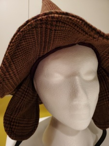 Under the brim (and showing the ear-flaps) on my witchy Sherlock hat