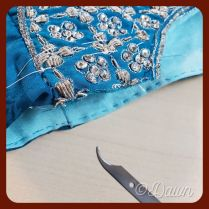 removing the long basting stitches after the lining has been stitched in by hand