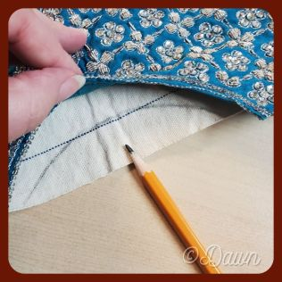 Tracing the curve onto the cotton canvas interlining