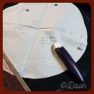 Using my existing Dockenbaret pattern (split brim hat) to cut out another version in black wool