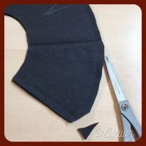 Trimming corners after sewing the outer edges on my black wool Dockenbaret
