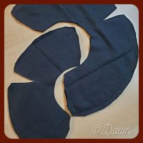 Dockenbaret in black wool brim sewn together