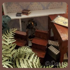 miniature library (or bed) steps within the setting of all the little things I made for her.