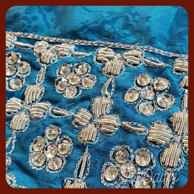 gorgeous teal fabric embellished with silver beads, sequins, and French Wire