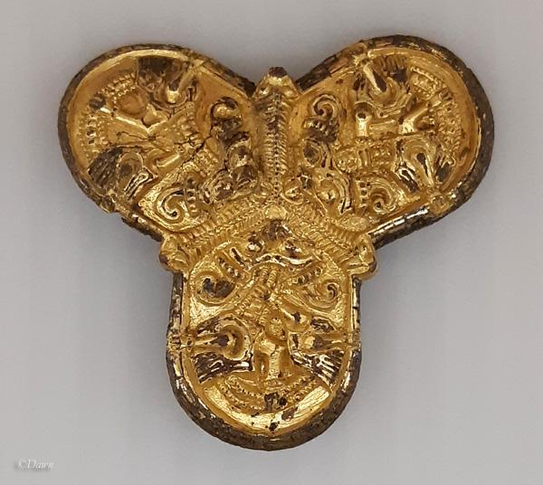 gilt trefoil brooch from Denmark on display in the Royal Alberta Museum