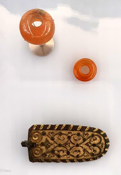 spindle whorl, polished amber bead & strap end mount
