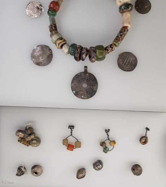Beads and coins from a Viking Age woman's grave.