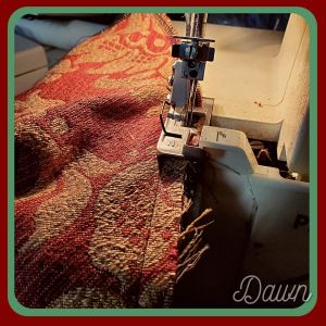 Using my serger on the raw edges of my red and gold damask sideless surcote