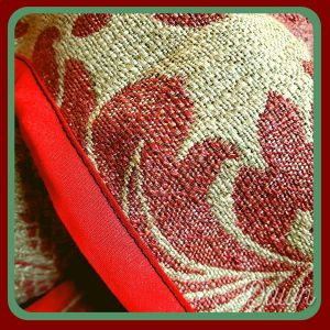 The red bias tape is a bit bright compared to the red in the damask, but it's covered on the outside completely by the golden braid.